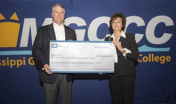 File Ingalls Shipbuilding President Brian Cuccias, left, and Mary S. Graham, president of Mississippi Gulf Coast College hold the check representing the donation Ingalls made to MGCCC to purchase welding machines. (Photo: HII)