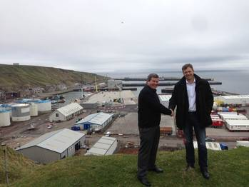 File Shaking hands on a trailblazing agreement – Hugh Simpson, left, and Knut Magne Johannessen at Scrabster Harbour