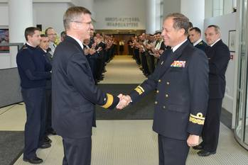 File Outgoing DCOM Rear Admiral Martens shakes hands with incoming DCOM Rear Admiral Bauzá as the Operational HQ staff applaud (Photo courtesy EU NAVFOR)