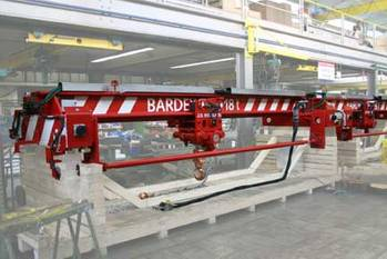 File A hydraulically operated overhead crane with a hoist lift capacity of 18 tons, manufactured by J D Neuhaus for Bardex Corporation