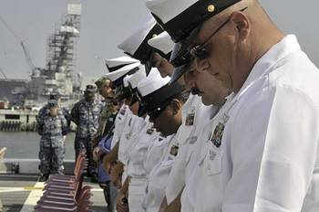 File USS New York crew members: Image courtesy of USN