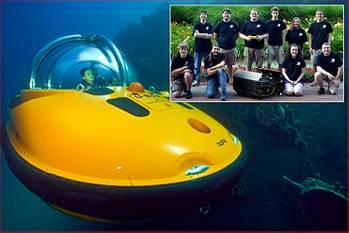 File Main photo - One of U-Boat Worx personal submarines, Inset photo – NCSU Robotics club with their Seawolf AUV and club president Matt Wiggins center holding JW Fishers pinger (Photo Credit: David Pearlman)