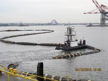 File Dredged sand was used to cap or close the Newark Bay CDF. This photo shows the floating pipeline that connected the dredge to the pump barge at the CDF site. Credit: Linda Guenther, Project Engineer, Dredging Program, New York District, U.S. Army Corps of Engineers.