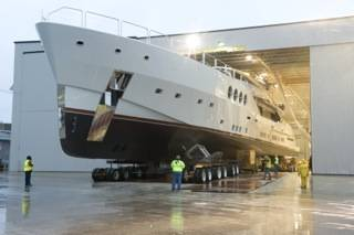 File After a trek that often involved steering with only inches of clearance and a complex 90-degree turn, Chris Holland, president of HMR Supplies, moves this new 215-foot, 480-ton superyacht out of the fabrication facility and to the barge for its initial launch and sea trials.