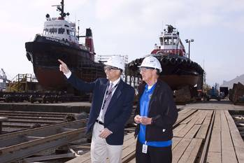 File (left to right, Mark Houghton , Vice-President, Seaspan Marine Operations and Walter Gretzky tour Vancouver Shipyards)