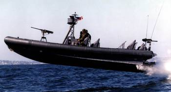 File Naval Special Warfare (NSW) 11-meter Rigid-Hull Inflatable Boat (RIB) during a training exercise conducted by Naval Amphibious Base (NAB) Coronado, San Diego. The airborne launch shown here is not uncommon for such craft.  Landings are characterized by high-acceleration impacts that may be damaging to structure, mechanical and electrical systems, and people. (U.S. Navy photo)