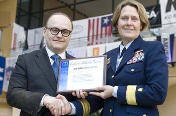 File Nigel Cleave, CEO of Videotel, presenting a commemorative plaque to Rear Admiral Linda Fagan at CMA Shipping 2012.