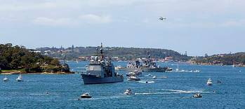 File USS Chosin leads JDS Makinami through Sydney Harbour during the warship entry as part of the International Fleet Review 2013. (Photo: ABIS Cassie McBride)