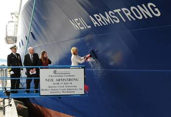 File Carol Armstrong, ship sponsor for R/V Neil Armstrong, breaking the bottle across the bow.