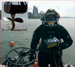 File Randive diver with Pulse 8X metal detector, Inset photo: Recovered propeller