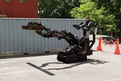 "File ""Big-Arm,"" the Teleoperation robotic system. (Photos: courtesy Raytheon)"