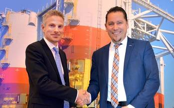 File Remi Eriksen, DNV GL Group COO and Executive Vice President, shaking hands with Stein Eggan, Chief Executive Officer of Marine Cybernetics (Photo courtesy DNV GL)