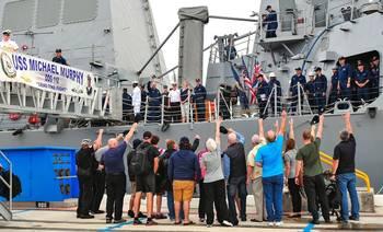 File Protecteur civilians cheer USS Michael Murphy: Photo credit USN