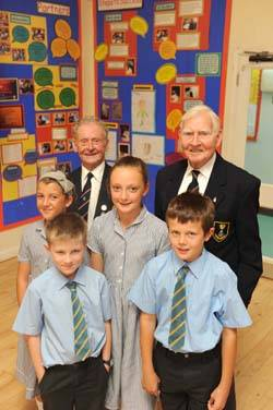File Residents from the Royal Alfred Seafarers' Society Geoffrey Talbot and Roy Ticehurst [L-R] with pupils from St Anne's Primary School in Banstead Emma Prichard, Rowan Stott, Katie Costello and Niall Cogavin [L-R]