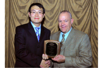 File Yang Zhao receives SEG award: Photo courtesy of SEC
