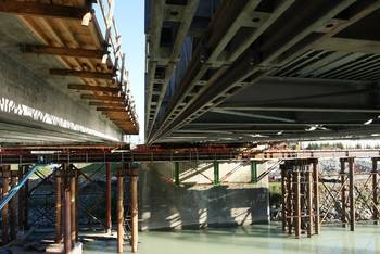 File Omega Morgan specially designed a truss beam for the installation of the collapsed Skagit River Bridge.  Piles could not be driven under the Akrow Bridge (part of the Skagit Bridge) so the company's 70-foot trussed beam was specially made to support the new 950-ton bridge. (Photo courtesy Omega Morgan.)