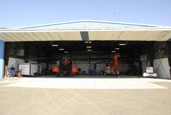 File Two Kodiak-based MH-60 Jayhawk helicopters sit in a Barrow Airport hangar ready to respond to any maritime search and rescue emergency July 10, 2012.