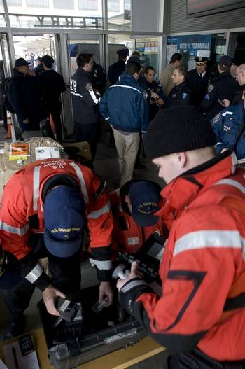 File NEW YORK – Coast Guard law enforcement officers, from Station New York, prepare to help administer drug and alcohol tests to the crew of the Seastreak ferry at Pier 11, Manhattan, Jan. 9, 2013.