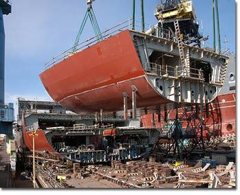 File A section of the hull of the USNS Medgar Evers (T-AKE 13) lowered into place in January of 2011.