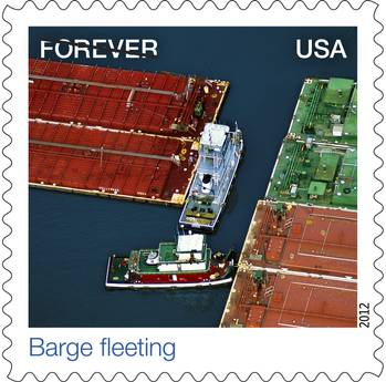 "File U.S. Postal Stamp: ""Barge Fleeting,"" an aerial view of towing vessels."
