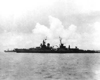 File USS Indianapolis (CA-35) preparing to leave Tinian after delivering atomic bomb components, circa July 26, 1945. She was sunk on July 30 while en route to the Philippines. (Donation of Major Harley G. Toomey, Jr., USAF(Retired), 1971, who took this photograph. U.S. Naval Historical Center Photograph)