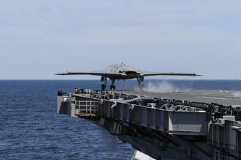 File Unmanned Aircraft Takes Off from Carrier: Photo credit USN