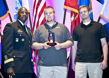 File Army Brig. Gen. Darrell K. Williams (left) presents award to Wing representatives Dave Ackroyd and Aaron Powell.