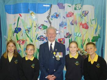 File  Royal Navy Veteran Roy Ticehurst with pupils from Woodmansterne Primary School Helen Marshall, James Stephenson, Azura Stones and Dylan Brown, all aged 11