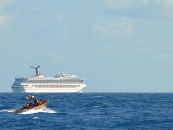 File Carnival Triumph & Coast Guard Cutter: Photo credit USCG