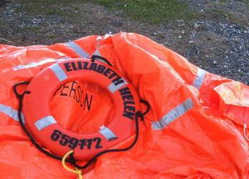 File liferaft from the 55-foot fishing vessel Elizabeth Helen, homeported in West Kingston, R.I., is shown after two fishermen were rescued three miles northeast of Block Island, R.I.
