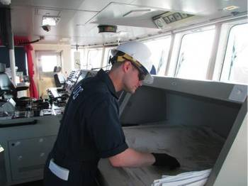 File Petty Officer 2nd Class Cody Johnson, a marine inspector stationed at Marine Safety Unit Cleveland, inspects navigation equipment aboard the motor vessel Fortunagract for compliance with international and domestic regulations April 19, 2014. Fortunagracht was the first vessel of its kind to enter the Great Lakes as part of the newly-formed Cleveland-Europe Express. U.S. Coast Guard photo by Lt. Stephanie Pitts