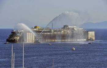 File The Costa Concordia wreck is expected to reach Genoa Saturday (Photo courtesy of Titan Salvage)