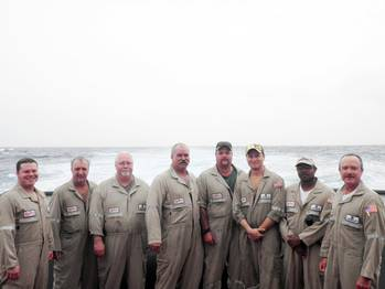 File left to right: Alan Williams, AB; Doug Carson, third mate; Pat McGee, cook; Ron Robinson, chief mate; Chris Farmer, AB/tankerman; Vince Mull, chief engineer; Travis Stringer, AB/tankerman, and  Gus Cramer, captain.