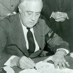 File President Franklin D. Roosevelt signing into law the Lend-Lease Act. (Image courtesy of Library of Congress)