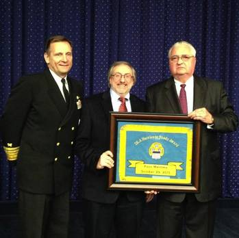 File John Tirpak, far right, accepting the hand-embroidered flag award for Foss. The flag is made by a Philadelphia based woman-owned business in the spirit of Betsy Ross.