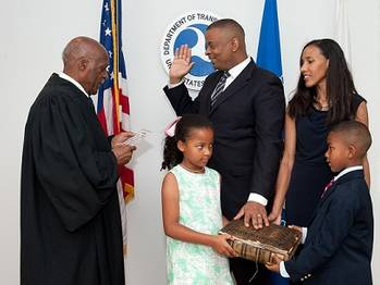 File Anthony Foxx is sworn in as U.S. Secretary of Transportation by Judge Nathaniel Jones with wife, Samara, and children, Hillary and Zachary.