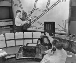 File Air traffic controllers plot the positions of aircraft on a wall-mounted display, circa 1950. Will control of ships at sea evolve as did air traffic control?
