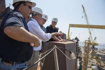 File Rep. Bradley Byrne (second from left) toured Ingalls Shipbuilding and the amphibious transport dock John P. Murtha (LPD 26). Pictured with Byrne are (left to right) LPD 26 Ship Construction Manager Hank Corcoran, LPD Program Director Mike Duthu and Ingalls Shipbuilding President Brian Cuccias. Rep. Steven Palazzo also participated in the tour but is not pictured. Photo by Andrew Young/HII