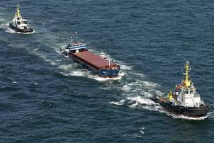 File The Janina under tow by Multraship tugs, July 2010 (Photo credit: Sky Pictures)