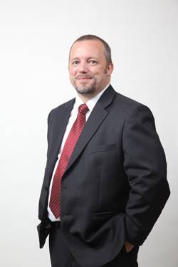 File John Phillips, Manager Director.