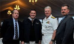 "File From Left: John O'Malley, owner and publisher, Marine Technology Reporter; Rob Howard, VP Sales & Marketing; U.S. Navy CNO Admiral Gary Roughead; and Greg Trauthwein, Associate Publisher and Editor. The CNO was conferred ""Seamaster 2011"" at the OceanTech Expo in Newport, RI. (Photo: U.S. Navy)"