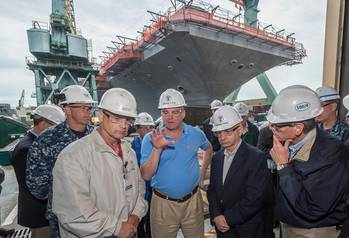 File Pictured with U.S. Sens. Tim Kaine and Jack Reed  in front of USS Abraham Lincoln are (left to right) Capt. Karl Thomas, the ship's commanding officer; Todd West, director, Newport News' RCOH program; and Chris Miner, Newport News' vice president of in-service aircraft carrier programs. Photo by Chris Oxley, Huntington Ingalls Industries