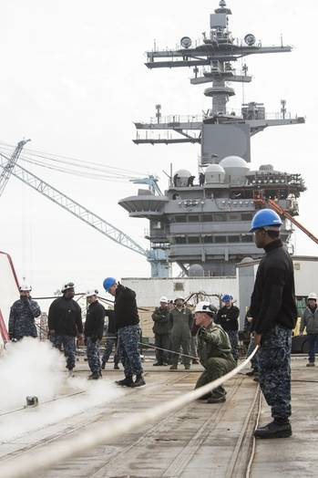 File Sailors signal steam catapult systems testing aboard the aircraft carrier USS Abraham Lincoln (CVN 72). Lincoln is in its final stages of testing all of its steam-powered systems as part of its refueling and complex overhaul (RCOH). (Photo: John Whalen/HII)