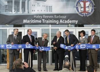 File Haley Reeves Barbour (center), the former governor of Mississippi, officially opens the Maritime Training Academy, which bears his name. Also participating in the ribbon-cutting are (left to right) Mike Mangum, president, Jackson County Board of Supervisors; Mississippi State Sen. Brice Wiggins; Irwin F. Edenzon, president, Ingalls Shipbuilding; Mike Petters, president and CEO, Huntington Ingalls Industries; Dr. Mary Graham, president, Mississippi Gulf Coast Community College; and U.S. Rep. Stev