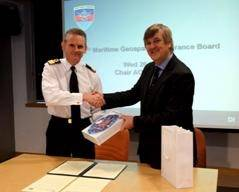 File Commodore Guy Robinson from Navy Command Headquarters shaking hands with Geraint West, the NOC's Director of National Marine Facilities after the signing of the Memorandum of Understanding