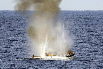 File Pirate skiff destroyed: Photo credit ABIS Jayson Tufrey, Commonwealth of Australia