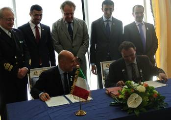 File Ugo Salerno (seated, left) signing the agreement with Drydocks World