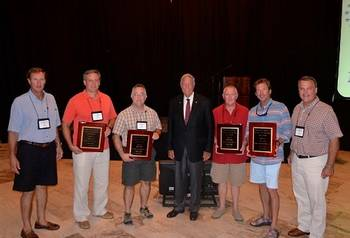 File Pictured Left to Right: Mike Lapeyrouse (AEU), Otto Candies, Jr. (Candies Shipbuilding), Perry Triche (US United Bulk Terminals), Coach Gene Stallings, Bill Hardy (Beacon Maritime), John Bullock (Willis of AL representing Signal International), Jimmy Burgin (AEU)