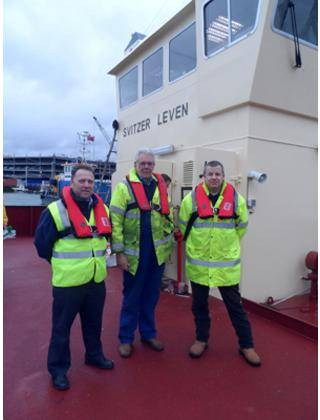 File Wearing the new K2- 275 twin chamber lifejackets (left-right): Andy Bracewell –  Sales Manager, Mr Robert Gray – Managing Director at Southampton Marine Services , Andy Norwood – Health and Safety Officer, Svitzer, UK