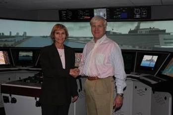 File Denise Johnston, Director, Resolve Maritime Academy (left) and Svein Sleipnes, Senior Vice President, Marine Operations at Norwegian Cruise Line (right) at Resolve Maritime Academy's Simulation Training Center